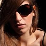 Moody beautiful woman in sunglasses — Stock Photo