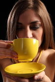 Woman drinking cup of hot tea — Stock Photo
