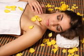 Woman lying in health spa asleep — Stock Photo