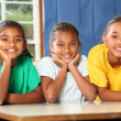 Three happy young school girls — Stock Photo