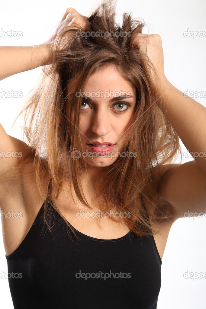 Woman with long hair having a frustrating bad hair day  — Stock Photo #5931386