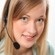 Blonde woman with headset — Stock Photo