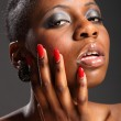 Black girl with red nails — Stock Photo