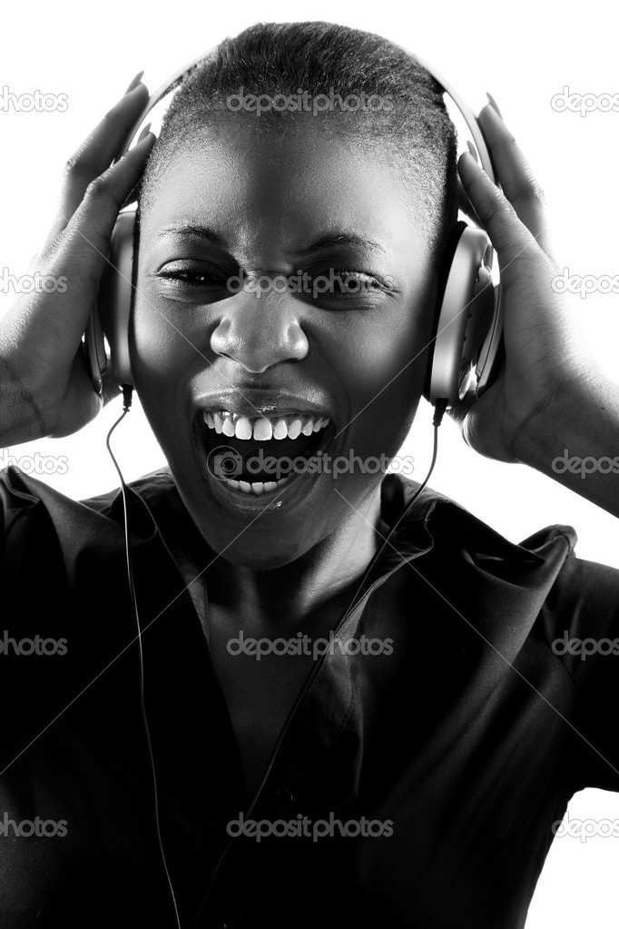 Black woman singing to music on headphones — Stock Photo #5965647