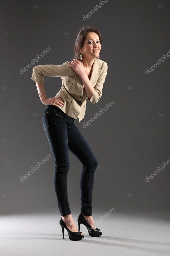 Sexy pose from girl in skinny jeans — Stock Photo ...