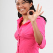 Okay sign from woman in pink — Stock Photo
