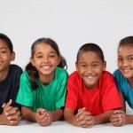 Smiling school kids on floor — Stock Photo #5973986