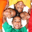 Happy young school friends boys and girls together in huddle — Stock Photo #5974028