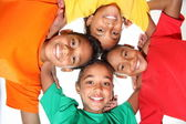 Happy young school friends boys and girls together in huddle — Stock Photo