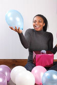 Party fun balloons and birthday present at home — Stock Photo