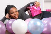 Young girl party time with present and balloons — Stock Photo