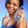 Beautiful healthy black girl with bottled water - Stock Photo