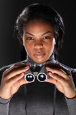 Female secret agent spy holding binoculars — Stock Photo