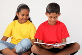 Two school kids reading a book — Stock Photo