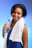 Beautiful smiling young black girl after fitness — Stock Photo