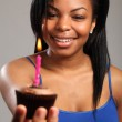 Beautiful young black girl with birthday cake — Stock Photo