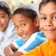 Three smiling primary school boys — Stock Photo
