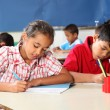 Boy and girl in classroom concentrating on lesson — Stock Photo