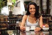 Girl having coffee in bistro — Stock Photo