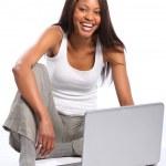 Happy black woman using laptop — Stock Photo