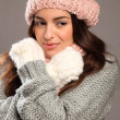 Girl in warm winter woollies looking away smiles — Stock Photo