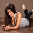 Beautiful happy woman relaxed reading text message — Stock Photo #6057028