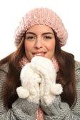 Beautiful young woman keeping warm in winter wool — Stock Photo