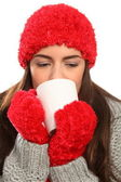 Woman with warm wollies and mug — Stock Photo