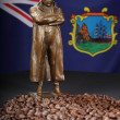 Napoleon figure with St Helena roast coffee beans - Stock Photo