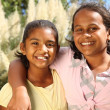 Two young girls in friendship hug — Stock Photo