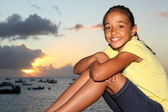 Young girl enjoying sunset at the seaside — Stock Photo
