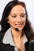 Business telesales by smiling young woman — Stock Photo