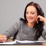 Happy smile doing homework for beautiful woman — Stock Photo