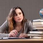 Checking the globe a teenage girl doing homework — Stock Photo