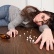 Teenager prescription drug overdose on floor — Stockfoto