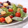 Healthy green salad with croutons and tomatoes — Stock Photo