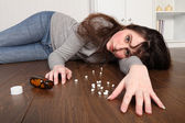 Teenager prescription drug overdose on floor — Stock Photo