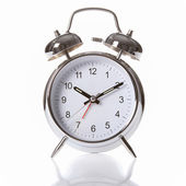 Silver chrome alarm clock with ringing bells — Stock Photo