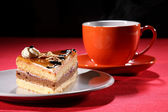 Hot drink and coffee cake with whipped cream — Stock Photo