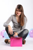 Beautiful happy young woman with birthday gift — Stock Photo