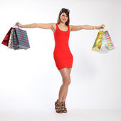 Shop till you drop sexy young girl holds up bags — Stock Photo