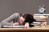 Student falls asleep doing homework late at night — Stock Photo