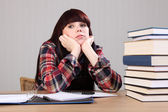 Young student girl tired taking a homework break — Stock Photo