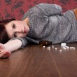 Teenager overdose on pills lying on floor — Stock Photo