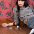 Teenagers cry for help lying on floor with pills — Stockfoto