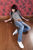 Suicide attempt from young girl lying on floor — Stock Photo