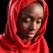 African American muslim girl in hijab looks down - Stockfoto
