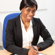 Beautiful smile by black woman in business office — Stock Photo