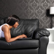 Beautiful african american woman at home with PC — Stock Photo #6166772