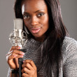 Portrait happy black woman singer in music studio — Stock Photo